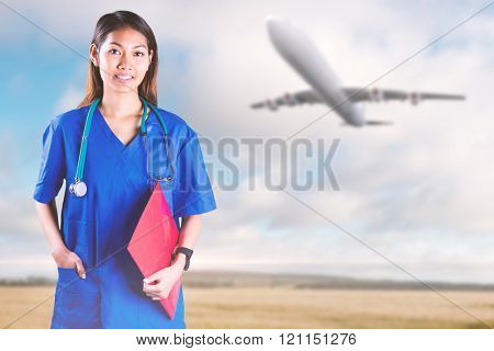 Asian nurse with stethoscope looking at the camera against fields backgrounds