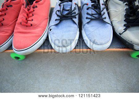 closeup of skateboarding  sneakers at skate park