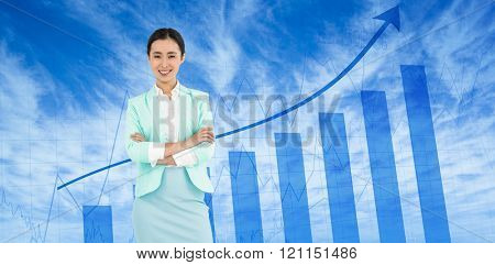 Elegant businesswoman with crossed arms against blue data