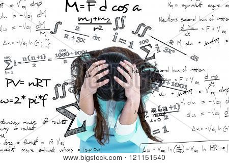 Worried businesswoman holding her head against maths equation
