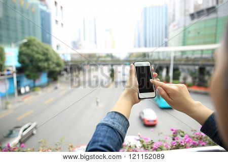 people hans use smart phone at city