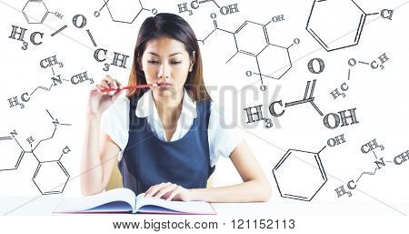 Thoughtful businesswoman reading against science formula