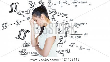 Casual upset businesswoman with head bowed against maths equation