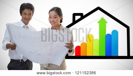 Estate agent looking at blueprint with potential buyer against energy efficient house graphic against a white background