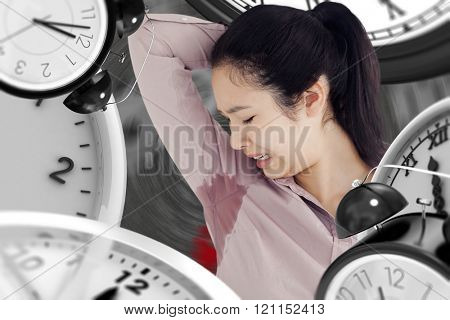 Woman disgusted at her own sweating against black background