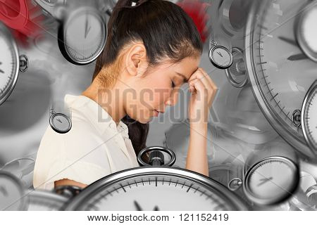 Casual upset businesswoman with head bowed against grey background