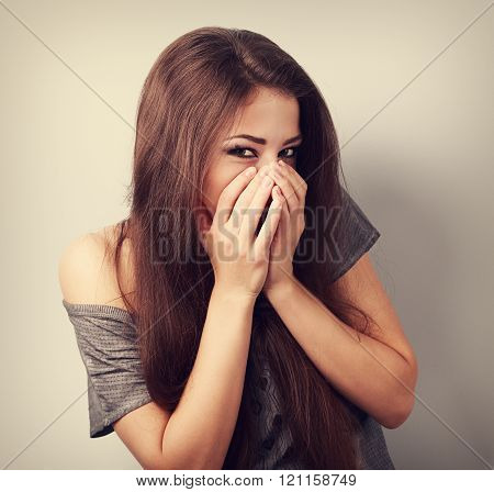 Happy Laughing Young Woman Cover Two Hands Her Mouth With Fun Look. Toned Closeup Portrait