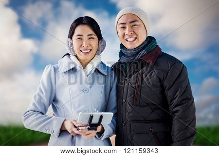 Cheerful couple against buildings against road leading out to the horizon