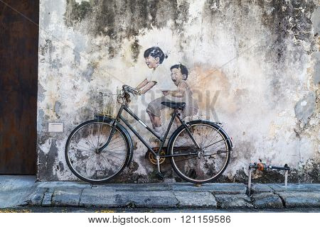 Penang, December 16, 2015:  Mural Artwork By Artist Ernest Zacharevic Entitled Kids On Bicycle. The