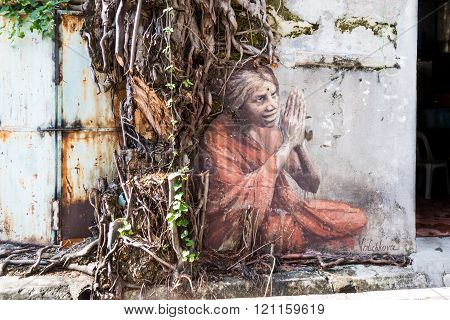 Penang, December 16, 2015:  Mural Artwork By Artist Julia Volchkova Depicts An Old Indian Lady Prayi