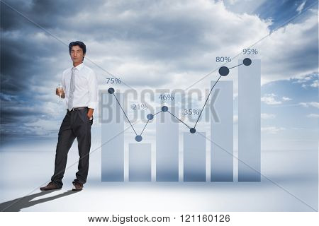 Serious man looking at camera holding champagne flute against view of percentage on graph