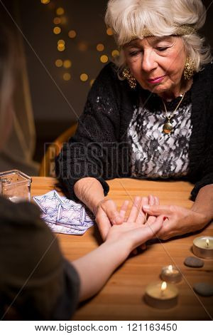 Fortuneteller Reading Somebody's Palm