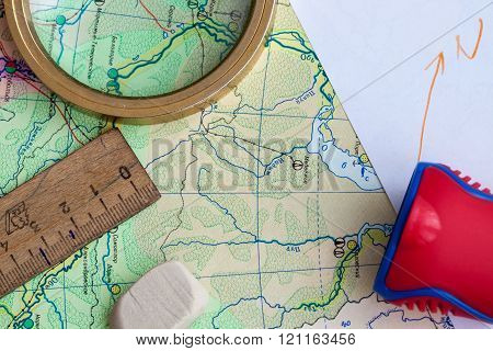 The Map, pencil and the magnifying glass