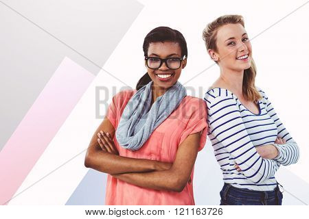 Women posing with arms crossed against colored background