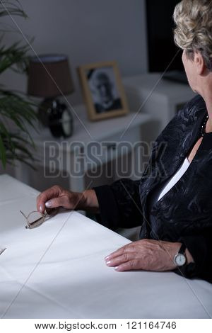 Widow Looking At Photograph