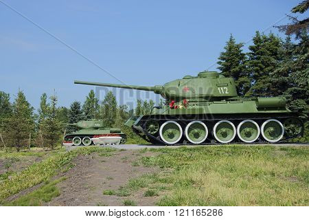 Two T-34-85 stand at the memorial