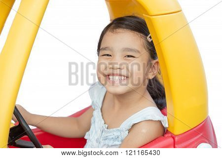 Asian Children Girl Driving Toy Car Yellow