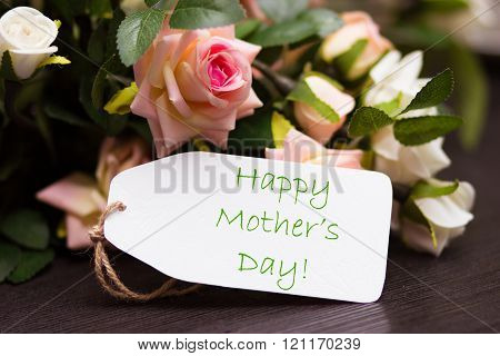 Happy mothers day card with rustic roses on wooden board
