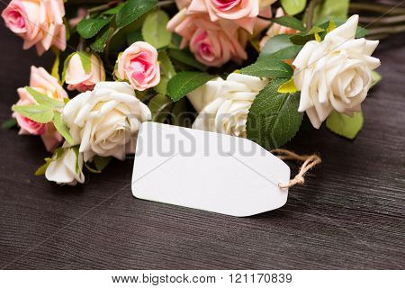Mothers day empty card with rustic roses on wooden board