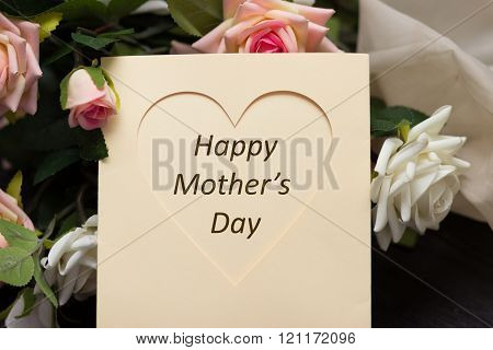 Mothers day heart card with rustic roses on wooden board