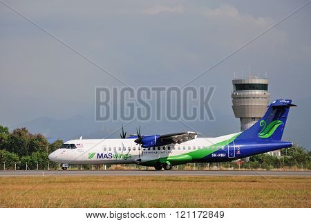 MASwings airplane taxiing at Kota Kinabalu International Airport