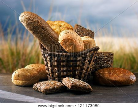 Many mixed breads and buns in a basket on the table