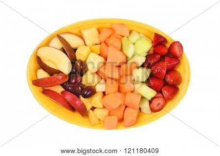 A platter of fresh cut fruit. Isolated on white fruits include, Strawberry, Pineapple, Apple, Cantaloupe, Honeydew Melon and Grapes.
