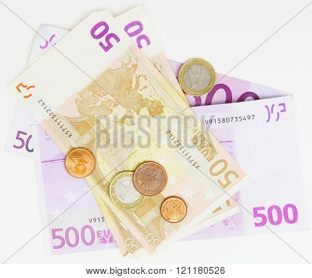 different bank note and coins on white background