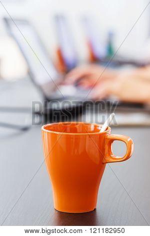 Coffee Mug And Notebook Computer