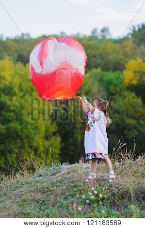girl holds sky lantern