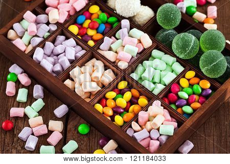 Mix Of Candies And Sweets In Wooden Box