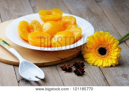 Peaches on the dish, spoon, anise and gerber