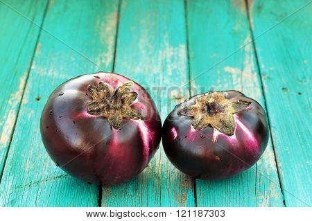 Pair Of Fresh Heirloom Organic Violet Eggplants On Turquoise Background