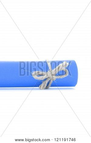 Handmade natural string knot tied on blue letter scroll isolated