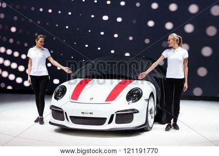 GENEVA, SWITZERLAND - MARCH 1: Geneva Motor Show on March 1, 2016 in Geneva, Porsche 911 R, premiere while cover goes off