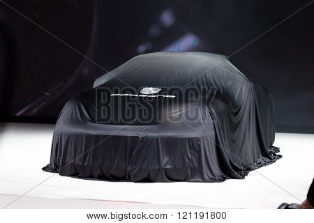GENEVA, SWITZERLAND - MARCH 1: Geneva Motor Show on March 1, 2016 in Geneva, Porsche 911 R, under cover before premiere