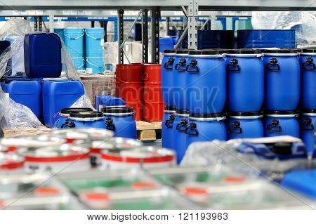 Plastic Barrels Or Drums Stored In A Warehouse