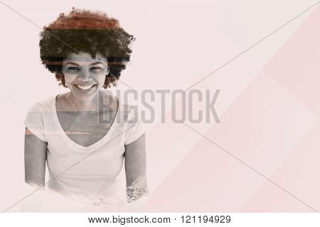 Smiling woman posing on white background against country scene with mountain