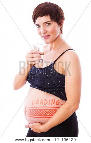 Pregnant woman drinking glass of water against loading