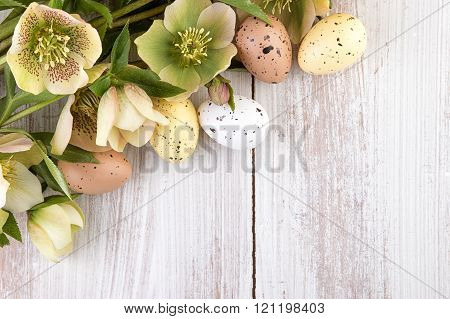 Easter decoration on light wood copy space