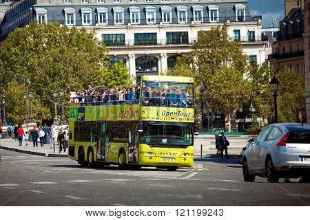 Yellow city sightseeing bus Neoplan on Paris city street.