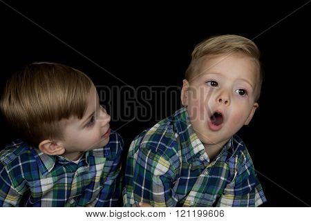 Candid Portrait Of Two Young Boys Wearing Matching Shirts