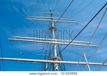 Mast Yacht Without Sails Against The Blue Sky