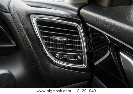 Detail with the air conditioning button inside a car.