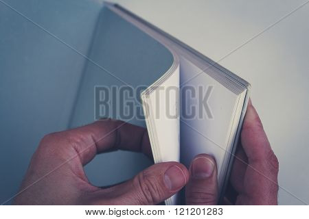 Hands Turning Pages In Empty Book With Blank Pages