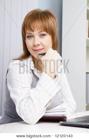 Attractive Young Woman In The Office
