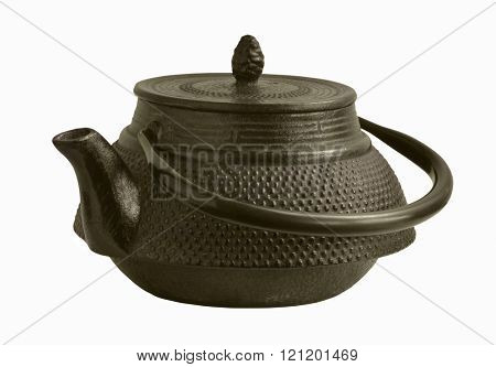 An old iron oriental teapot on white background. Very dark brown color.