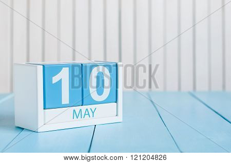 May 10th. Image of may 10 wooden color calendar on white background.  Spring day, empty space for te