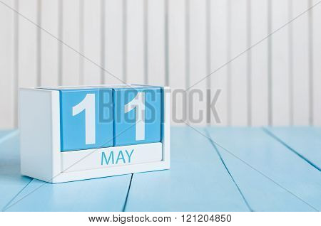 May 11th. Image of may 11 wooden color calendar on white background.  Spring day, empty space for te