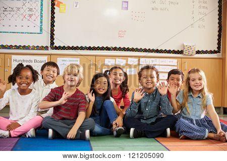 Elementary school kids sitting on classroom floor